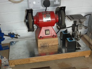 The grinding rest, grinding wheel and solid base showing steel surface and magnetic clamps.