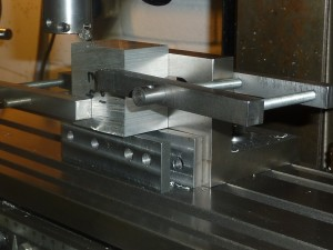 The set up for machining the datum edge square to the datum face on one of the engine blanks.  The parallels are just to set the height at this stage.