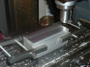 Machining the first datum face on one of the blanks for the multi-cylinder engine.