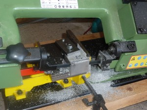 Cutting alloy blanks to size using the Warco band saw.