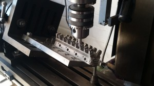 Pressing in the valve guides.